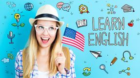 Thème anglais avec la jeune femme tenant le drapeau américain photos stock