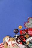 Thème de couture sur le bleu Photographie stock libre de droits