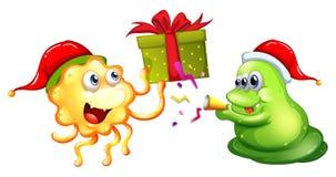 Thème de Noël avec les monstres et le présent Images libres de droits