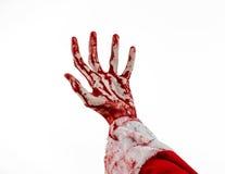 Thème de Noël et de Halloween : Main ensanglantée de Santa Zombie sur un fond blanc Photo libre de droits