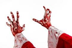 Thème de Noël et de Halloween : Main ensanglantée de Santa Zombie sur un fond blanc Photos libres de droits