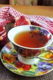 Thé avec de la confiture de framboise photo stock