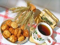 Thé avec la pâtisserie Image stock