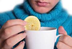 Thé avec le citron Photographie stock