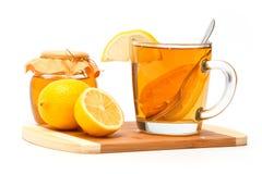 Thé avec le citron et le miel image stock