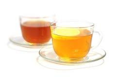 Thé avec un citron Photo stock
