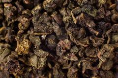 Thé brun grisâtre de Chinois d'oolong de vacarme Image libre de droits