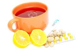 Thé chaud avec le citron Photos stock