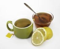 Thé, citron, et miel Photo stock
