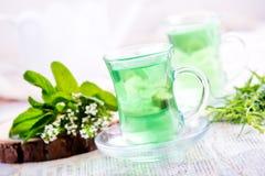 Thé dans des tasses Images stock