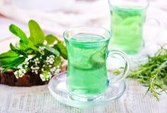 Thé dans des tasses Photographie stock libre de droits