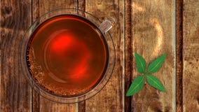 Thé dans la cuvette en verre Photographie stock libre de droits