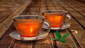 Thé dans la cuvette en verre Image stock