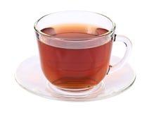 Thé dans la cuvette en verre d'isolement sur le fond blanc Photo libre de droits