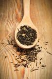 Thé dans une cuillère Photo stock