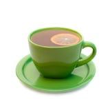 Thé de citron dans la cuvette verte. Image stock