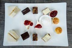 Thé et dessert d'après-midi Photographie stock libre de droits