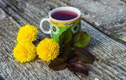 Thé et fleurs Photographie stock libre de droits