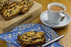 Thé et gâteau Images stock