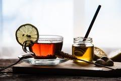 Thé et miel Photographie stock