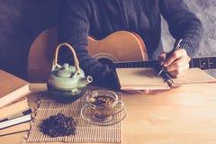 Thé et musique Images stock