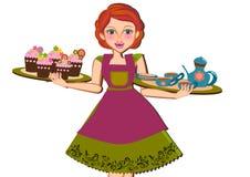 Thé et petits gâteaux de portion de femme Photographie stock libre de droits