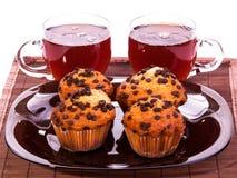 Tasses de thé et de petits pains Image libre de droits