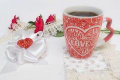 Thé et roses Photos stock