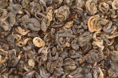 Thé noir chinois comme fond photo stock