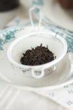 Thé noir, feuilles Photos stock