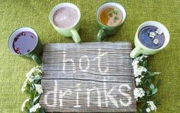 Thé noir, vert et de fruit, boissons chaudes, café, cacao Image stock