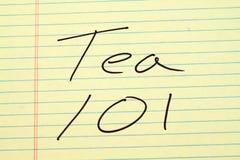 Thé 101 sur un tampon jaune Image stock
