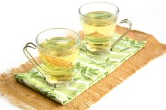 Thé vert dans des tasses en verre Photo libre de droits