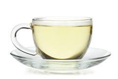 Thé vert dans la cuvette en verre Image stock