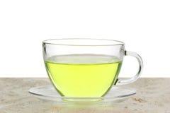 Thé vert dans une tasse en verre Images libres de droits