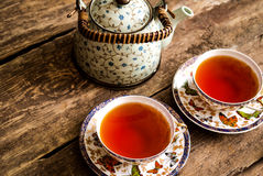 Thé vert de thé noir de théière Photo stock