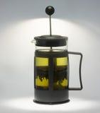 Théière avec du thé vert. Image stock
