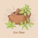 Théière et feuilles de thé Image stock