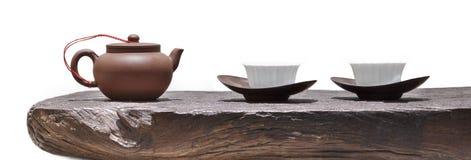 Théière et tasse sur le bois Image stock