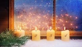 4th Advent, fönstergarneringar Royaltyfri Bild