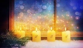4th Advent, fönstergarneringar Arkivbilder
