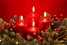 4th Advent red candle flower arrangement. 4th Advent red candle Christmas flower arrangement with berries Royalty Free Stock Photos