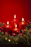 4th Advent red candle flower arrangement Stock Photo