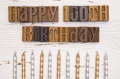 100th aniversário feliz soletrado no tipo grupo Fotografia de Stock Royalty Free