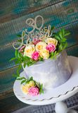 30th anniversary cake with roses on cake stand. 30th anniversary cake with roses and greenery on a cake stand stock image