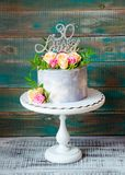 30th anniversary cake with roses on cake stand. 30th anniversary cake with roses and greenery on a cake stand stock photo