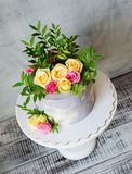 30th anniversary cake with roses on cake stand. 30th anniversary cake with roses and greenery on a cake stand stock images