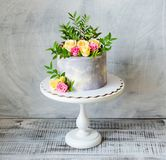 30th anniversary cake with roses on cake stand. 30th anniversary cake with roses and greenery on a cake stand Stock Photography