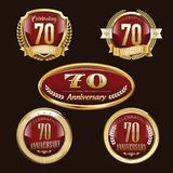 70th Anniversary emblems set. Set of anniversary isolated red emblems on black background. 70 golden years with gold ribbons stock illustration