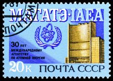 30th Anniversary of International Atomic Energy Agency, circa 1987. MOSCOW, RUSSIA - MAY 25, 2019: Postage stamp printed in Soviet Union devoted to 30th stock photography